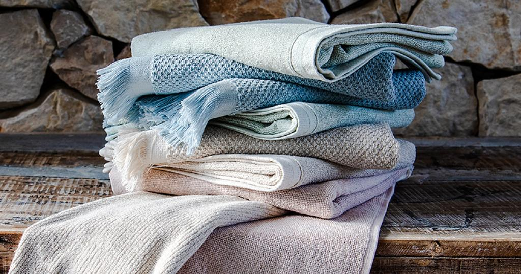 Stack of neatly folded Clarysse bath towels